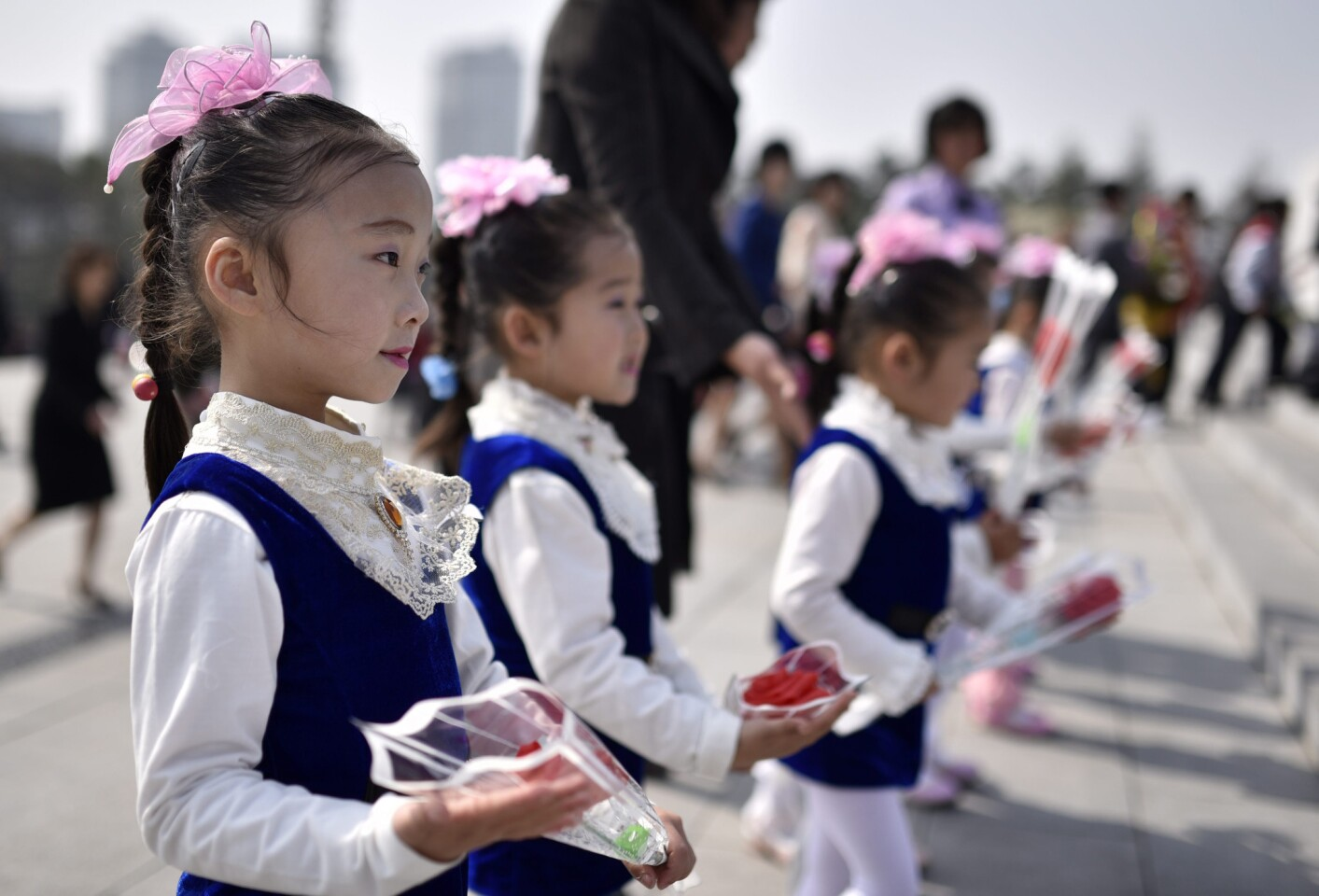 Children hold flowers on their way to pay respect to former leaders Kim Il-sung and Kim Jong-il at Mansu Hill in Pyongyang as North Korea marks the Day of the Sun on April 15.