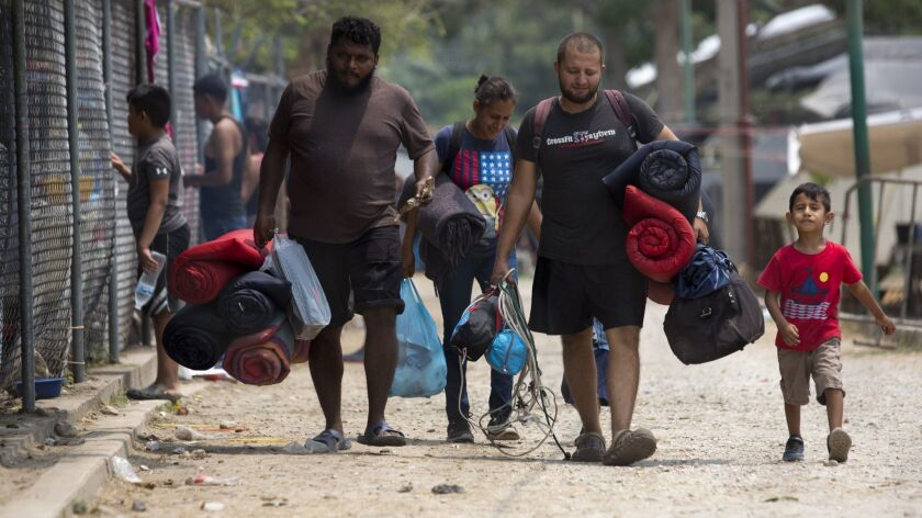 Honduran migrants leave the shelter April 28 where they had been staying temporarily in Mapastepec in Mexico's Chiapas state.
