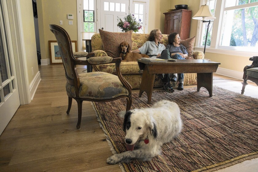 """NCIS: Los Angeles"" costar Linda Hunt, right, with her partner, Karen Klein, and their dogs sit in the living room of their recently renovated Craftsman home in Hollywood."