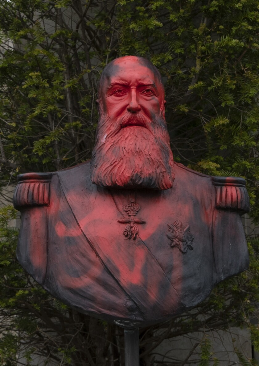 A bust of Belgium's King Leopold II is smeared with red paint and graffiti in Tervuren, Belgium, on June 9, 2020.