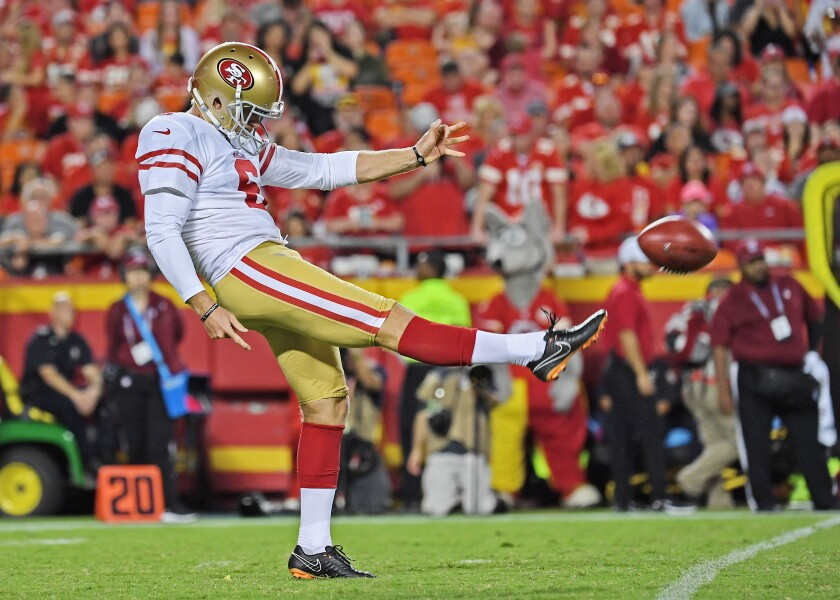 The 49ers' Mitch Wishnowsky punts the ball during a preseason game against the Chiefs on Aug. 24, 2019.