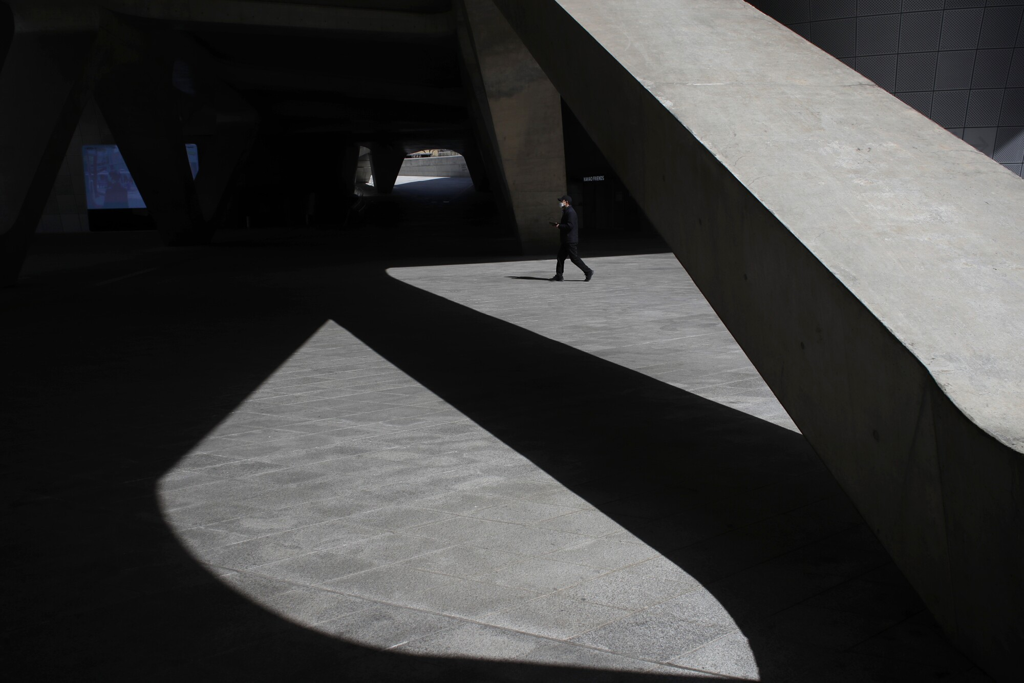 A man wearing a mask walks at Dongdaemun Design Plaza in Seoul.