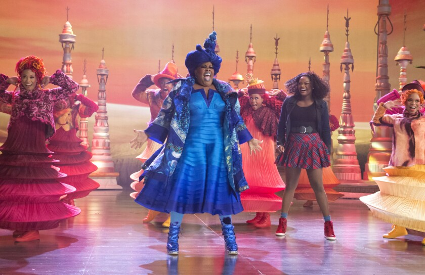 Amber Riley as Addapearle, center, and Shanice Williams as Dorothy.