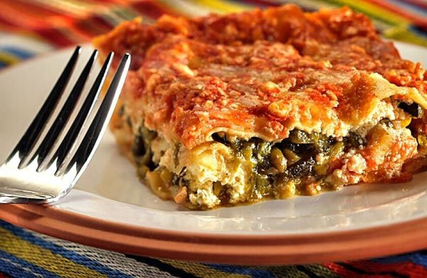 """Poblano chile strips and onions are the """"meat"""" in Mexican lasagna."""