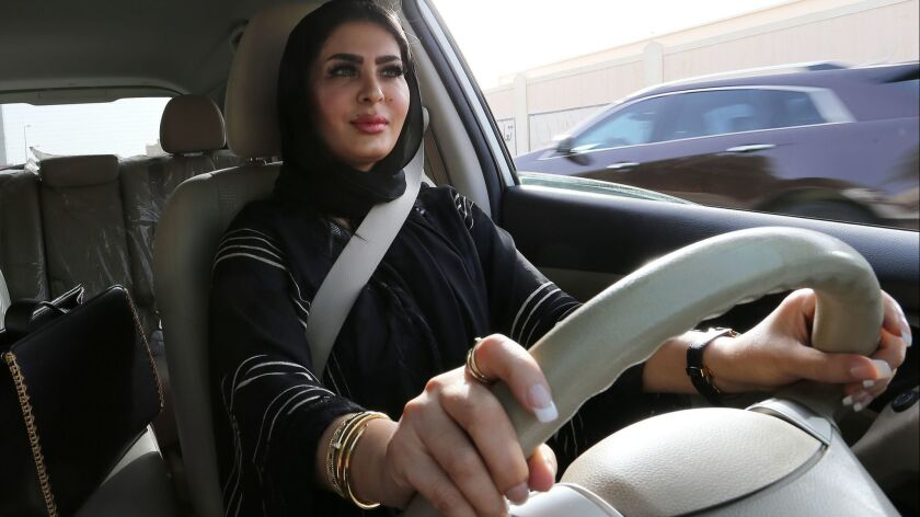 Huda Badri, 30, takes the wheel as decades-long ban on driving by women comes to an end in Saudi Arabia.