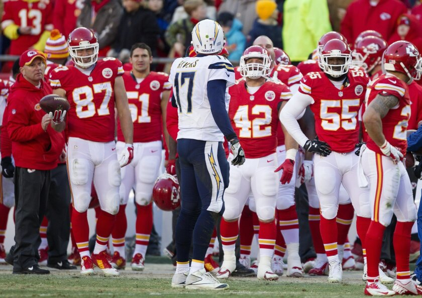 The San Diego Chargers vs. The Kansas City Chiefs at Arrowhead Stadium. San Diego Chargers quarterback Philip Rivers (17) jaws with the Kansas City Bench near the end of the game after an interception was called back due to a penalty.