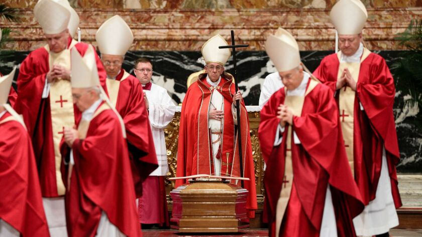 Pope Francis presides over the funeral ceremony for Cardinal Bernard Law on Dec. 21 in St. Peter's Basilica at the Vatican.