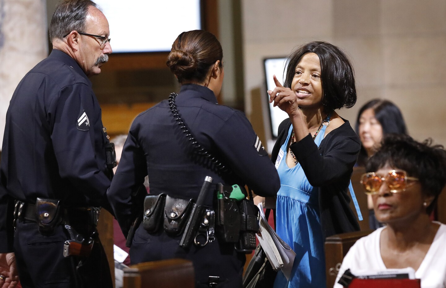 Yvonne Michelle Autry, right, is ejected during a City Council meeting.