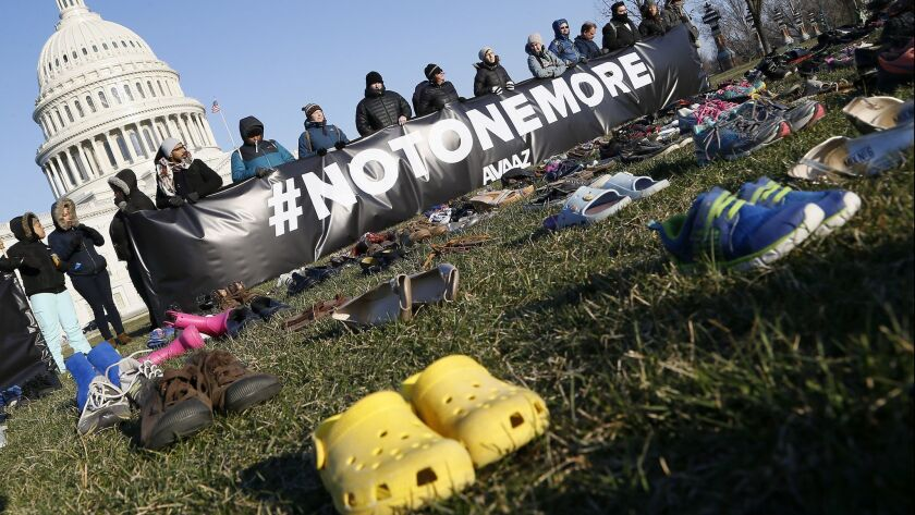 7,000 empty pairs of shoes for every child killed by guns in the U.S. since Sandy Hook cover the southeast lawn of U.S. Capitol Building on Tuesday, March 13.