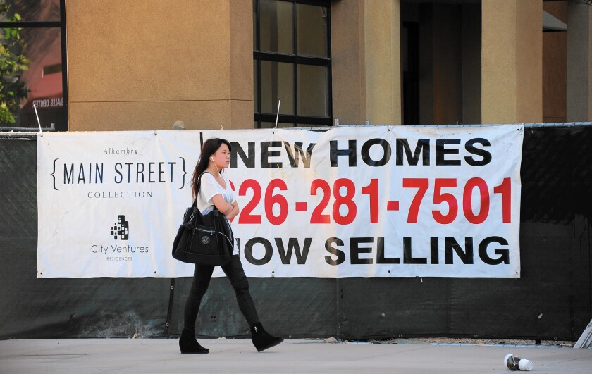 According to data from the Census' Current Population Survey, those moving out of California over the last 15 years listed housing as one of the most common factors, behind only family and job concerns. Above, a banner advertising new homes for sale in Alhambra in 2013.