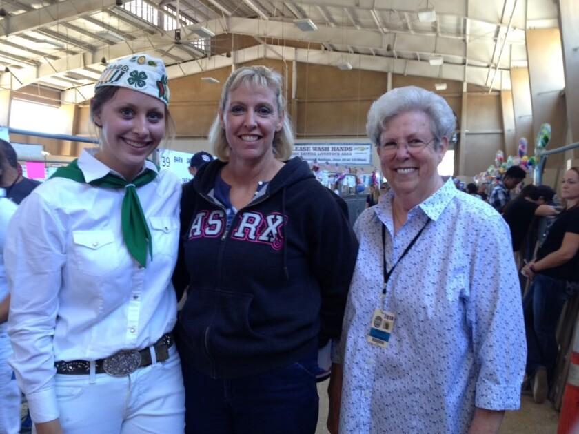 Three generations: Katie Phillips, 21; her mother Karen Phillips, 45; and cookie maker Sharon Toth, 76.