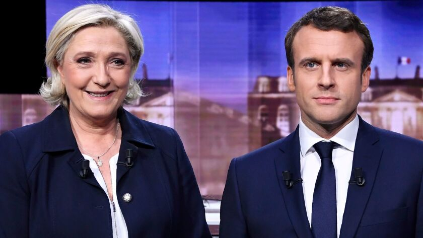 French presidential election candidate for the far-right Front National party, Marine Le Pen, left,