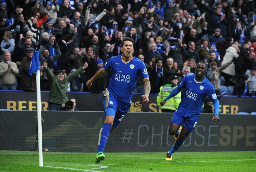 Leicester's Leonardo Ulloa, left, celebrates after scoring against Norwich during the English Premier League soccer match between Leicester City and Norwich City at the King Power Stadium in Leicester, England, Saturday, Feb. 27, 2016. (AP Photo/Rui Vieira)