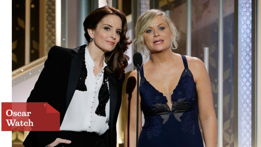 Hosts Tina Fey, left, and Amy Poehler at the 72nd Golden Globe Awards.