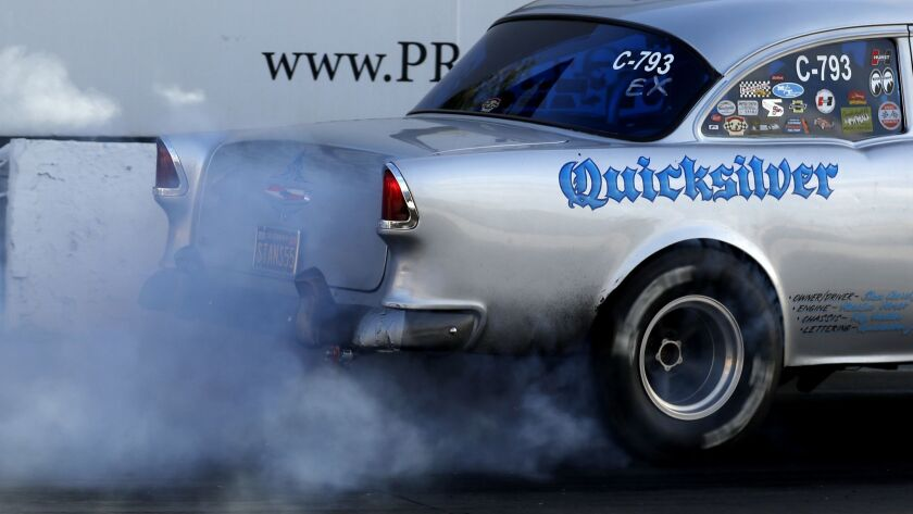 IRWINDALE, CALIF. - APR. 19, 2018. A driver burns rubber as a prelude to a drag race at the Irwind