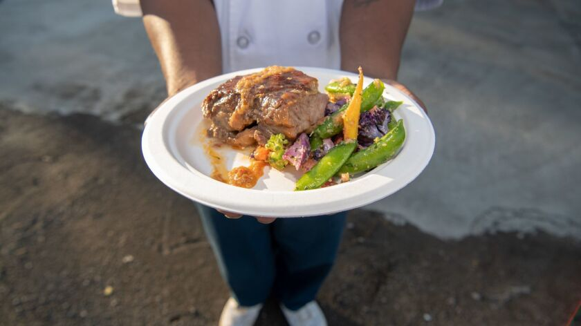 SAN QUENTIN, CA-May 22, 2019: Derry Brown showcases the beef dish, one of four dishes he and fellow