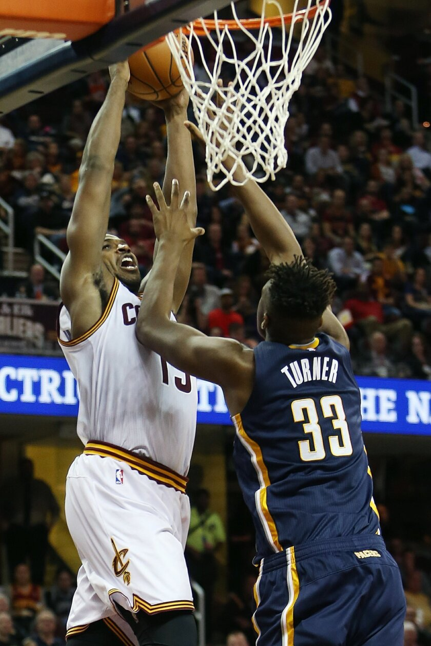 Cleveland Cavaliers center Tristan Thompson (13) goes up for a dunk over Indiana Pacers forward Myles Turner (33) during the second half of an NBA basketball game, Sunday, Nov. 8, 2015, in Cleveland. The Cavaliers won 101-97. (AP Photo/Ron Schwane)