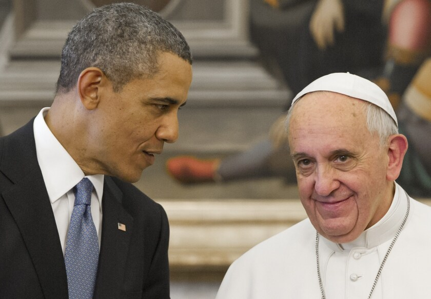 Pope Francis speaks with President Obama during a private audience on March 27 at the Vatican.