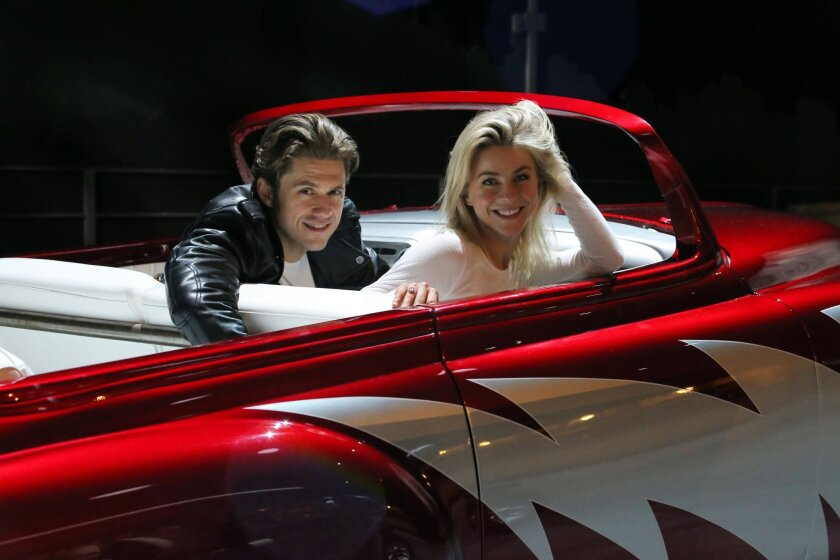 """In this 2016 photo provided by FOX, Aaron Tveit, left, and Julianne Hough rehearse for """"Grease: Live,"""" airing live Sunday, Jan. 31, 2016 (7:00-10:00 PM ET live/PT tape-delayed), on FOX. (Kevin Estrada/FOX via AP)"""