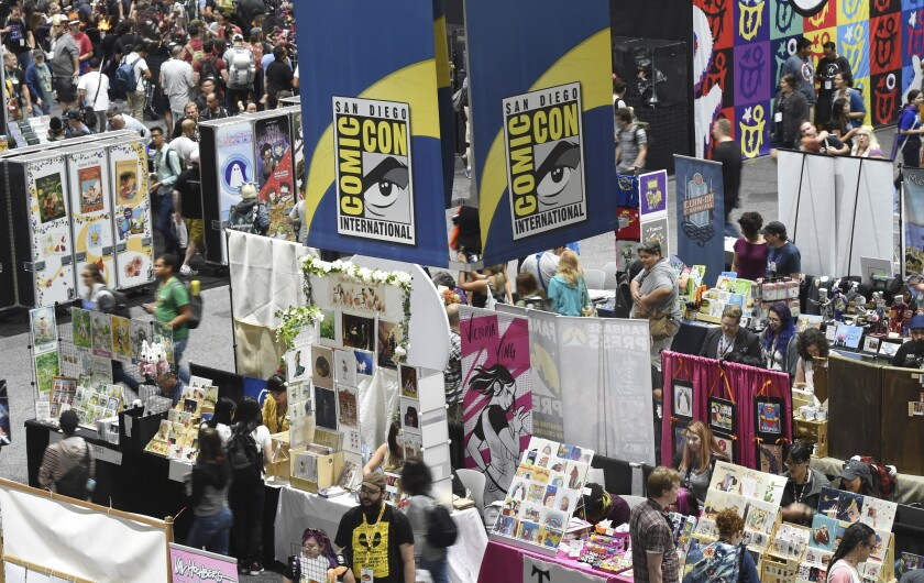 Comic-Con attendees walk the convention center floor during preview night at Comic-Con International on July 17, 2019.