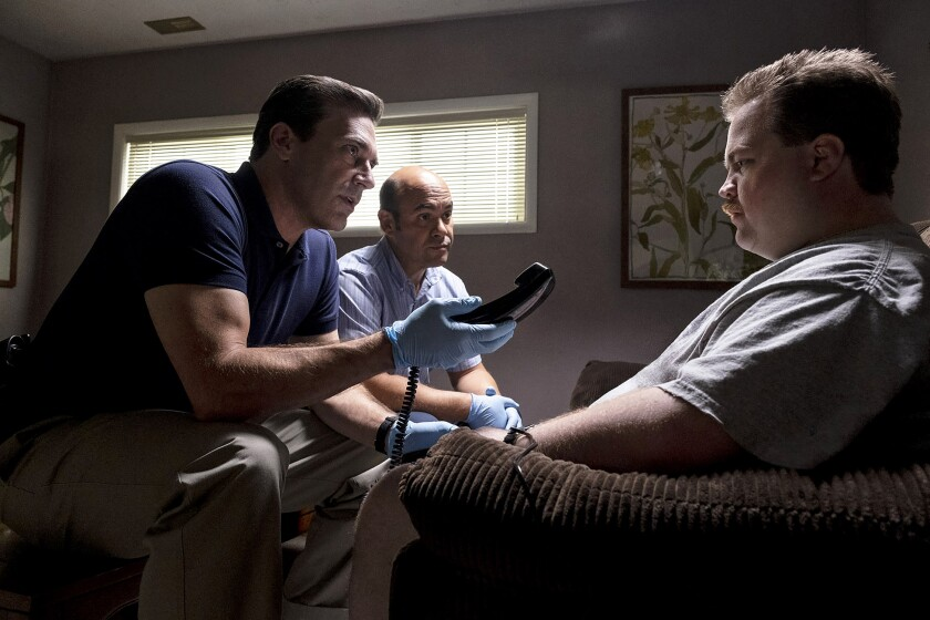 "Jon Hamm, Ian Gomez and Paul Walter Hauser in ""Richard Jewell."""
