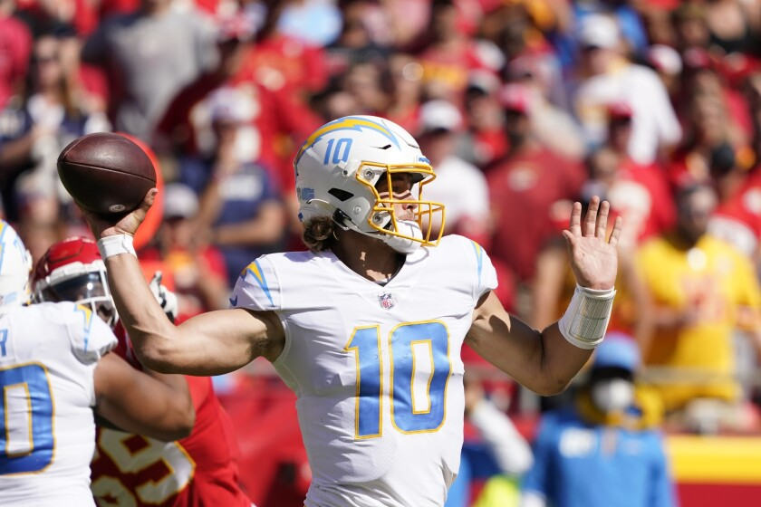 Chargers quarterback Justin Herbert throws during the second half of Sunday's win at Kansas City.