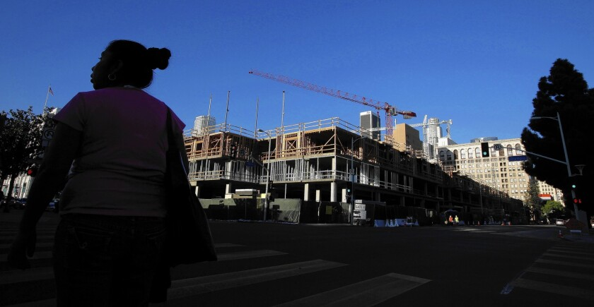 Building permits were issued for nearly 17,000 units in apartment and condo buildings in Los Angeles and Orange counties last year, the most since 2006, according to the Census Bureau. Above, an apartment complex under construction in downtown L.A. in January.