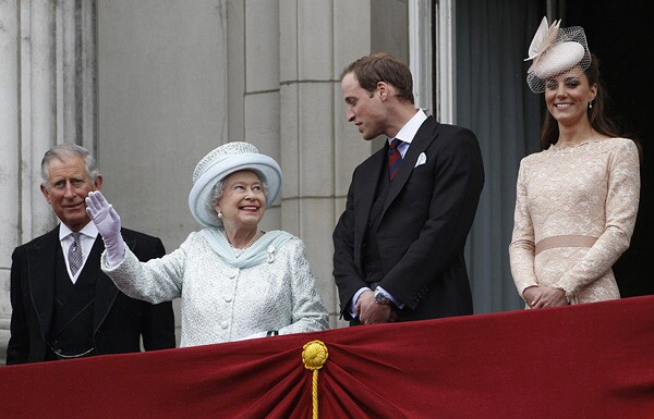 Queen Elizabeth waves from a balcony at Buckingham Palace accompanied by Prince Charles, Prince William and William's wife Kate Middleton, Duchess of Cambridge.
