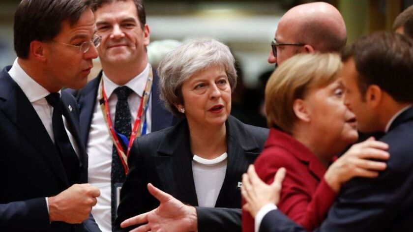 British Prime Minister Theresa May arrives for a meeting at a European Union summit in Brussels, Belgium, on Dec. 13.