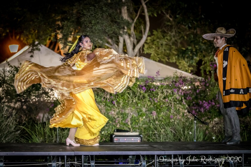 Two dancers perform the