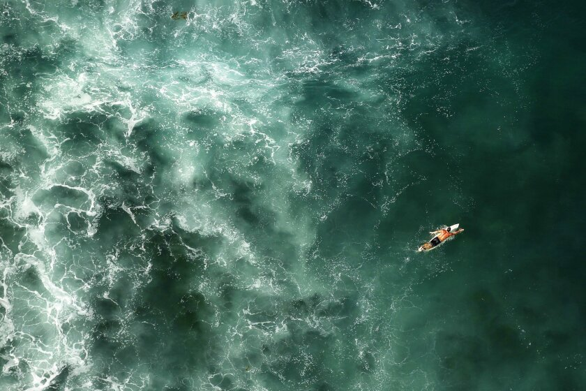 SAN DIEGO, CA-OCTOBER 7, 2015  | A surfer paddles at Windansea Beach in La Jolla.  |   (K.C. Alfred/ San Diego Union-Tribune