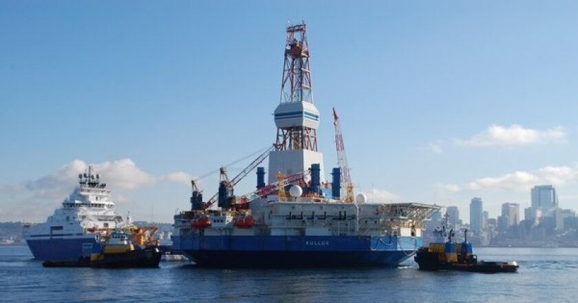 The Kulluk oil drilling rig is towed by the Aiviq as they set sail from Seattle earlier this year for offshore drilling in Alaska. The Coast Guard was evacuating the rig south of Kodiak after engine troubles on the tow vessel threatened to leave it adrift.