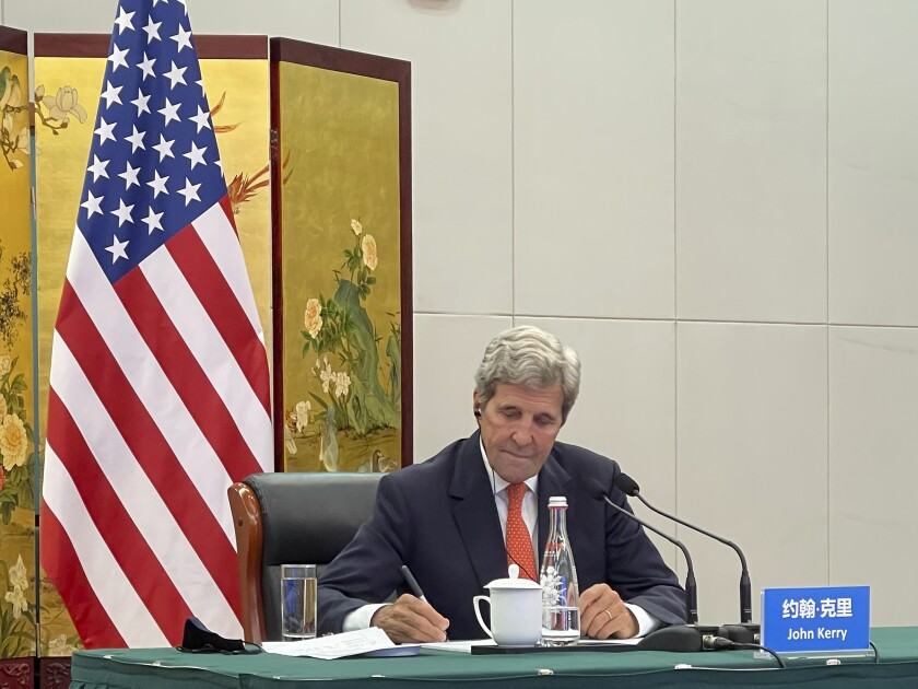 In this photo provided by the U.S. Department of State, U.S. Special Presidential Envoy for Climate John Kerry attends a meeting with Chinese Foreign Minister Wang Yi via video link in Tianjin, China, Wednesday, Sept. 1, 2021. Wang warned Kerry on Wednesday that deteriorating U.S.-China relations could undermine cooperation between the two on climate change. (U.S. Department of State via AP)