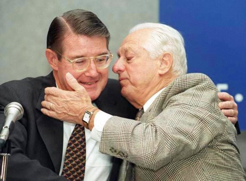 Tommy Lasorda hugs then-Dodgers owner Peter O'Malley.