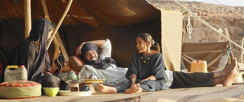 """Toulou Kiki, left, Ibrahim Ahmed a.k.a. Pino and Layla Walet Mohamed in """"Timbuktu."""""""
