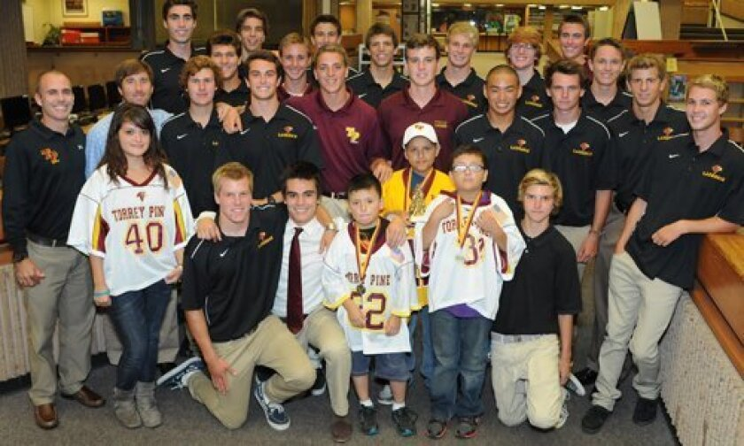 The Montano family kids with the Torrey Pines lacrosse team. Photos/McKenzie Images