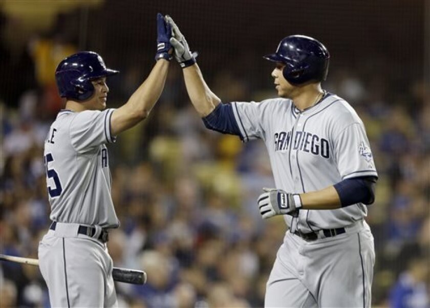 San Diego Padres' Kyle Blanks, right, is greeted by on-deck batter Will Venable after his solo home run against the Los Angeles Dodgers in the sixth inning of a baseball game in Los Angeles Wednesday, April 17, 2013. (AP Photo/Reed Saxon)