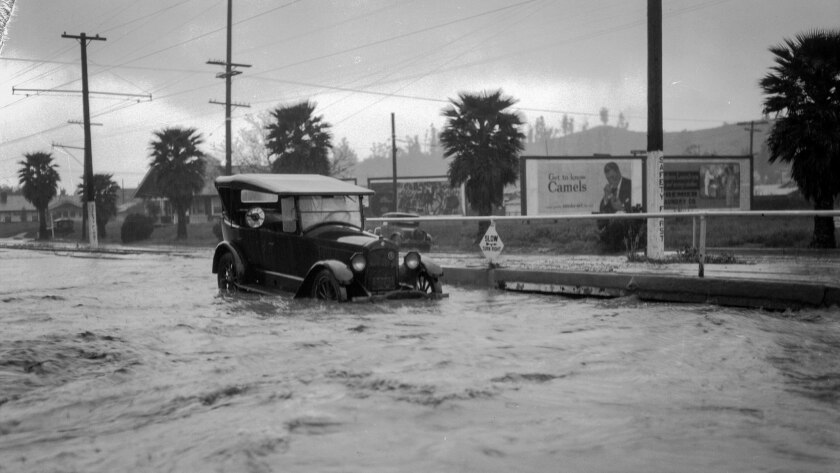 Automobile at flooded intersection of Yosemite Dr. and Eagle Rock Blvd. in Eagle Rock, Los Angeles,