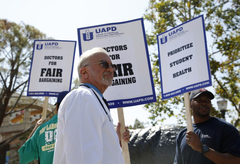 Dr. Stuart Bussey pickets outside the student health center at UCLA on April 11.