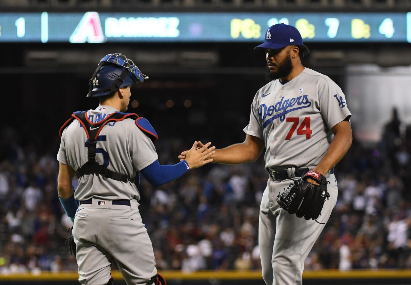 PHOENIX, ARIZONA - JUNE 20: Kenley Jansen #74 and Austin Barnes #15 of the Los Angeles Dodgers celebrate a 9-8 win over the Arizona Diamondbacks at Chase Field on June 20, 2021 in Phoenix, Arizona. (Photo by Norm Hall/Getty Images)