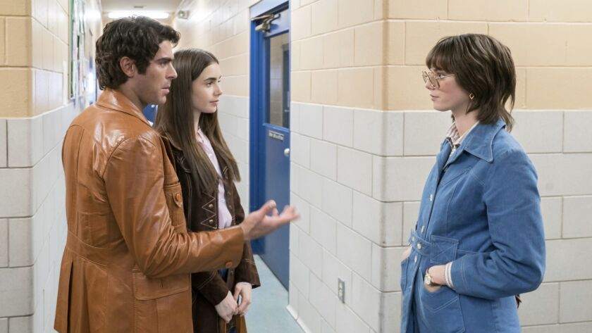 This image released by Netflix shows, from left, Zac Efron, Lily Collins and Kaya Scodelario in a sc