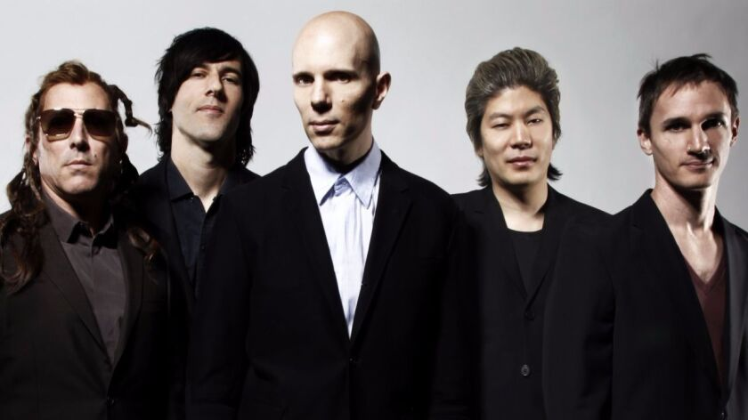 The bewigged  Maynard James Keenan (far left) and A Perfect Circle.
