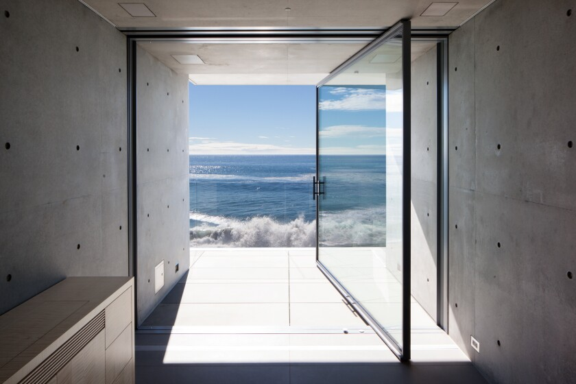 The concrete-clad architectural home, listed at $75 million, is among the most expensive homes publicly for sale in Malibu.