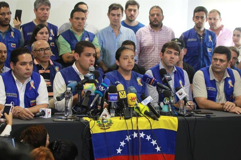 Members of Venezeula's opposition-controlled National Assembly, Jose Manuel Olivares (second from left) and Gaby Arellano (center) take part in a press conference, in Cucuta, Colombia, on Feb. 21, 2019, to discuss plans to shift humanitarian aid stockpiled in that city to their crisis-racked homeland. EPA-EFE/Ernesto Guzman Jr.