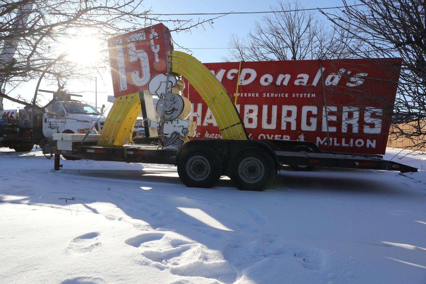 Workers dismantle the sign at the McDonald's museum in Des Plaines. A model of the first McDonald's franchise restaurant, the museum has been closed in recent years. McDonald's said visitors to the site have declined in the last decade since tourists have been barred from entering the space. Flooding in the area also continues to be a problem.