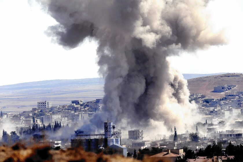 Smoke rises in Kobani, Syria, after an airstrike. The White House acknowledged that air power alone won't keep the city from falling into the hands of Islamic State militants.