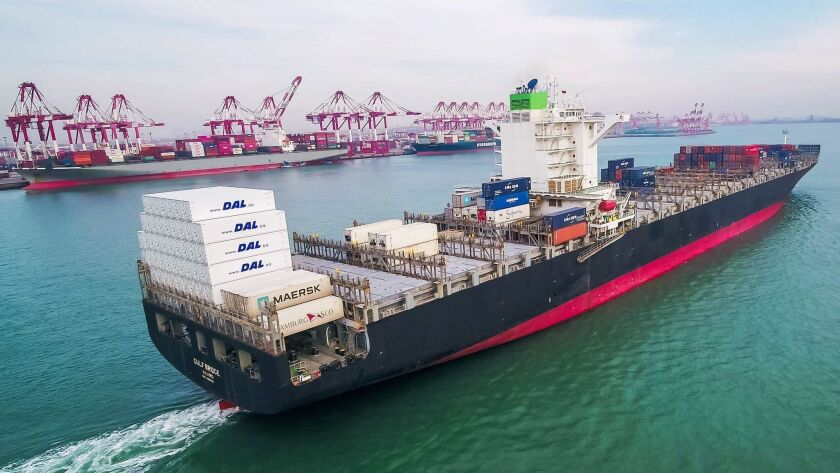 A cargo ship sails near a port in Qingdao in China's eastern Shandong province. U.S. retailers have stepped up purchases of Chinese products to avoid pending tariffs.