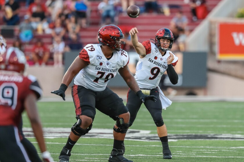 San Diego State quarterback Ryan Agnew delivers a pass during SDSU's 31-10 victory Saturday night at New Mexico State.