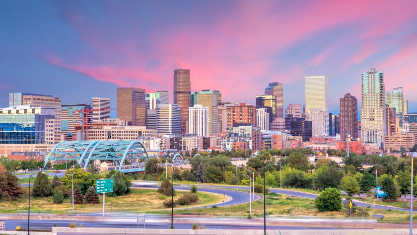 Panorama of Denver skyline at twilight.