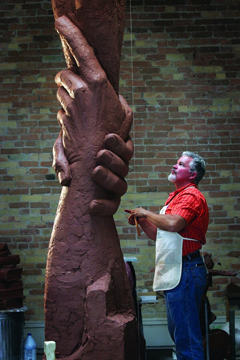 Artist Gary Lee Price works on a 13-foot-tall clay prototype of the Statue of Responsibility, which he designed. Kenneth Linge